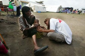 An MSF aid worker examines a malnourished child during a nutritional crisis in Ethiopia (2008) Picture by Juan Carlos Tomasi/MSF