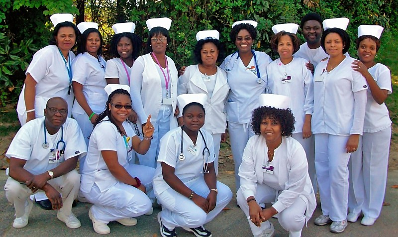 "Yetunde: ""I worked as the Director of Nursing in Silver Spring, Maryland. During nurse's week, my staff  celebrates nursing week by wearing nursing uniform with caps...here's a group snapshot of nursing team, 2010. We had fun!"""