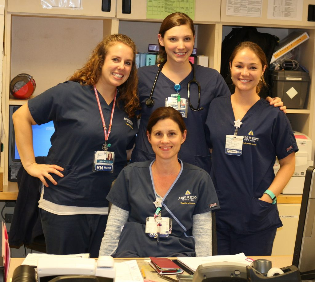 Nadya (left) with fellow nurses at Johns Hopkins Bayview Medical Center in Baltimore, Maryland.