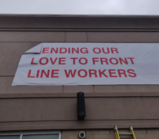 """When banners go wrong: """"Ending our love to front line workers"""""""